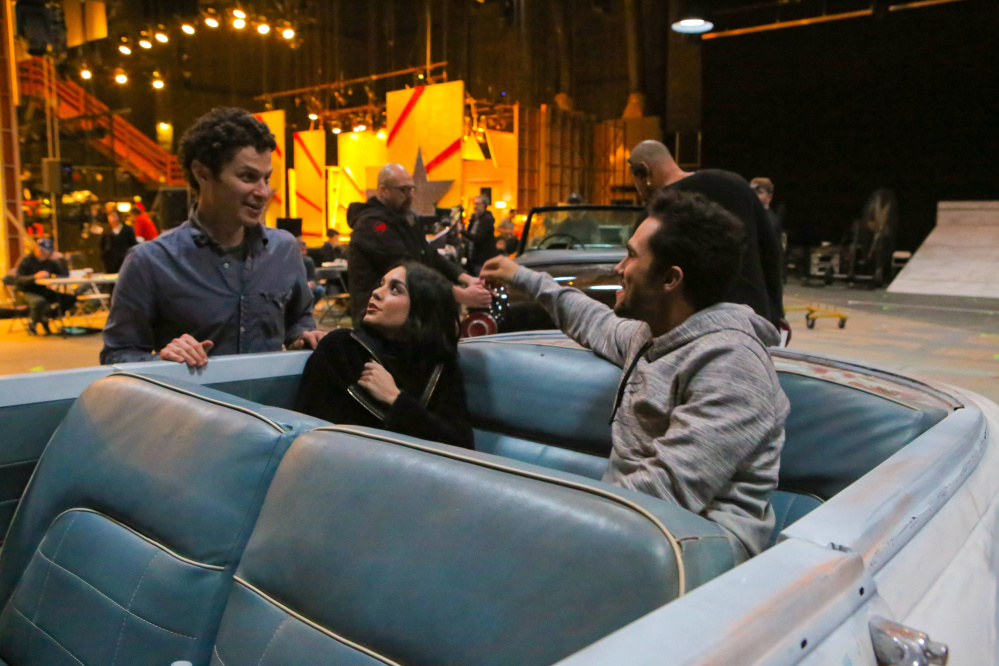 """In this 2016 photo provided by FOX, Thomas Kail, from left, Vanessa Hudgens, and Carlos PenaVega rehearse for """"Grease: Live,"""" airing live Sunday, Jan. 31, 2016 (7:00-10:00 PM ET live/PT tape-delayed), on FOX. (Kevin Estrada/FOX via AP)"""