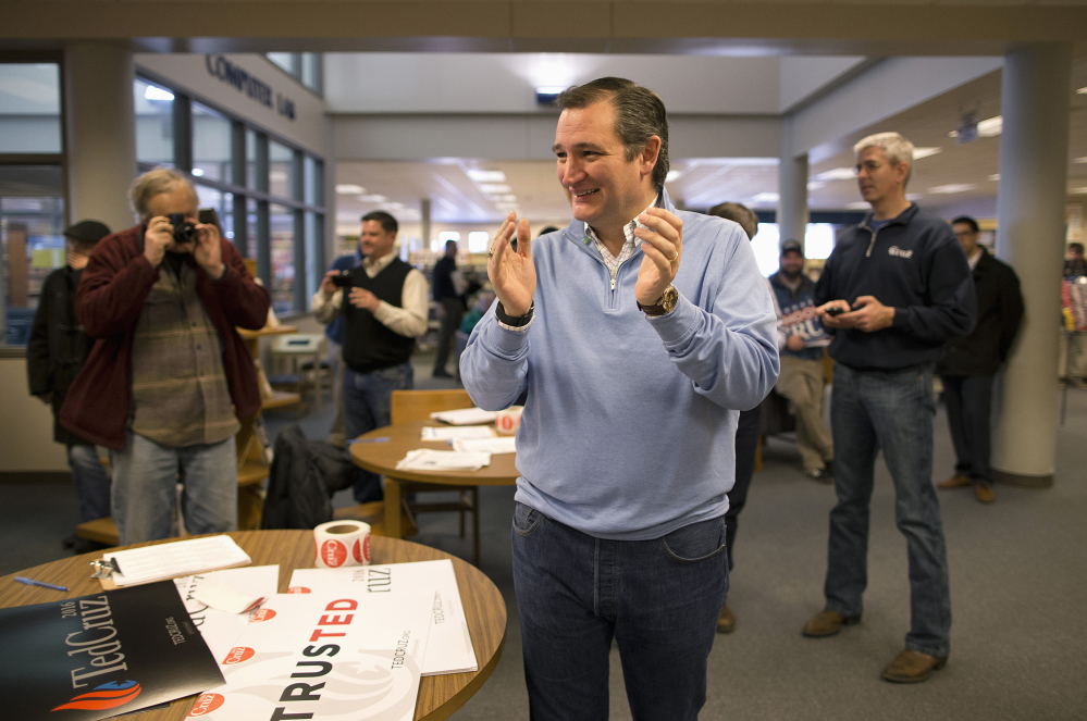 Republican presidential candidate, Sen. Ted Cruz, R-Texas, smiles during a campaign event Friday in Emmetsburg, Iowa, but some say his campaign is under siege.