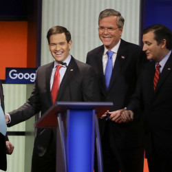 Republican presidential candidates, left to right, New Jersey Gov. Chris Christie, Sen. Marco Rubio, R-Fla., former Florida Gov. Jeb Bush and Sen. Ted Cruz, R-Texas, talk after the Republican presidential primary debate Thursday in Des Moines, Iowa.
