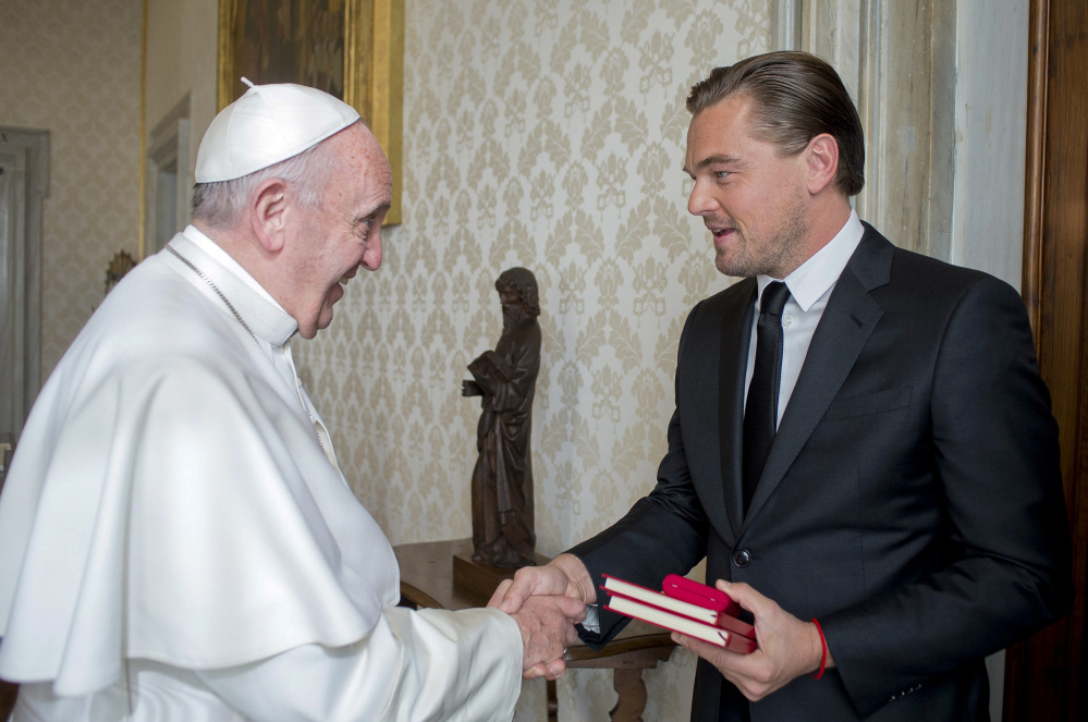 Pope Francis meets with actor Leonardo DiCaprio during an audience in the pontiff's private studio at the Vatican,