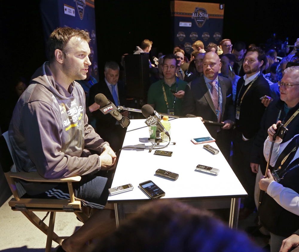 John Scott, elected by fans as captain of the Pacific Division All-Stars, drew a crowd of media members Friday as he answered questions about Sunday's All-Star game.