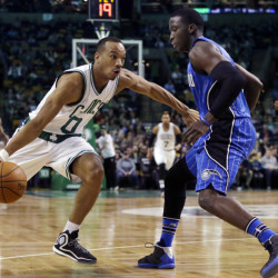 Celtics guard Avery Bradley drives against Orlando's Tobias Harris in the first quarter Friday night in Boston.