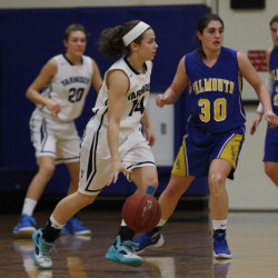 Jessica Kirk of Yarmouth looks for a teammate while being guarded by Falmouth's Adelaide Cooke. Yarmouth used a 20-0 run in the second and third quarters to pull away for a 48-25 win. Joel Page/Staff Photographer