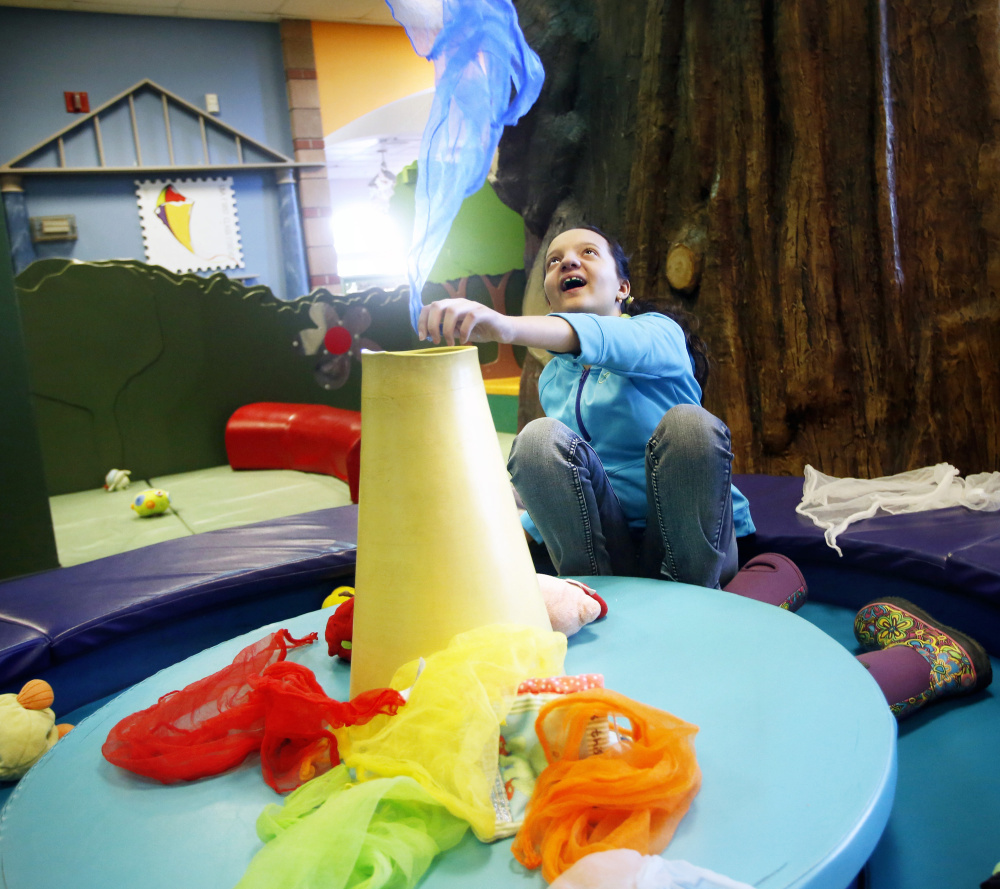 Eleven-year-old Hannah Taylor of Westbrook, who is autistic, plays in an exhibit at Portland Children's Museum on Saturday. Derek Davis/Staff Photographer