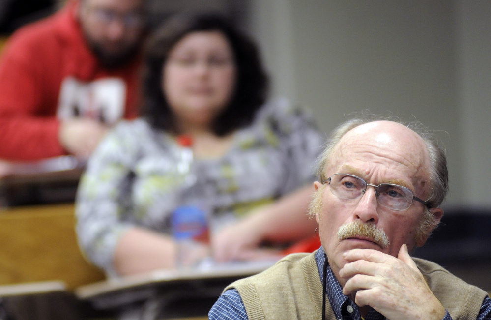 George Van Deventer, 80, listens to a lecture during a U.S. history class at the University of Maine at Augusta.