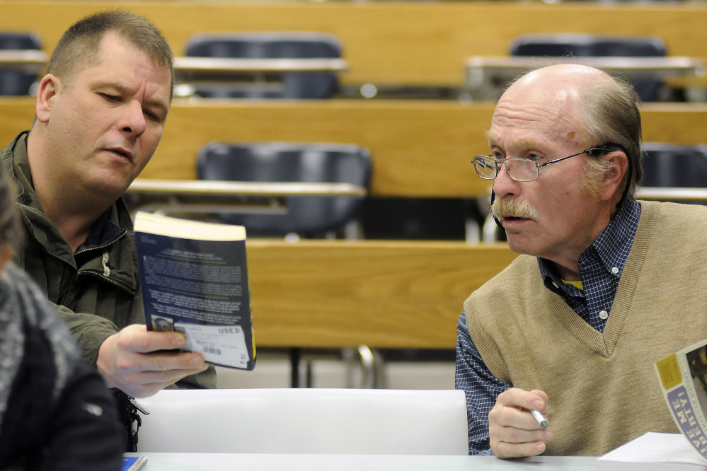 George Van Deventer, right, confers with classmate Roland Choate during a U.S. history class at the University of Maine at Augusta.