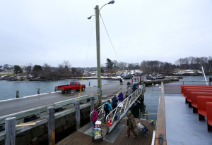 Passengers disembark  from the ferry on Chebeague Island in this Friday, Jan. 29 file photograph. The year-round population of the town hovers around 350, though one resident said this year's is closer to 400.