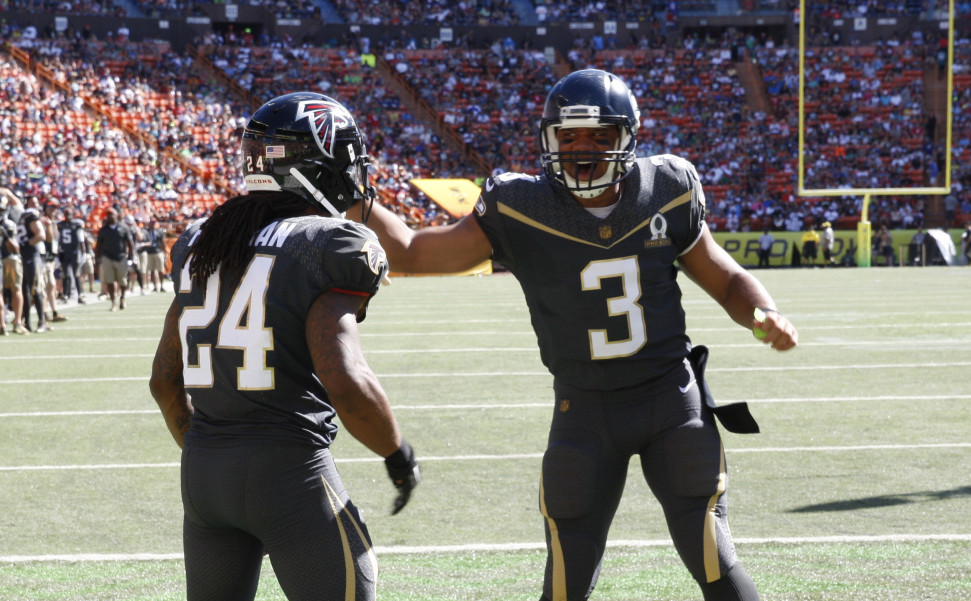 Atlanta Falcons running back Devonta Freeman, left, and Seattle Seahawks quarterback Russell Wilson of Team Irvin celebrate after Freeman scored a touchdown during the first quarter of the Pro Bowl Sunday in Honolulu.