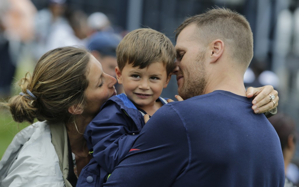 New England Patriots quarterback Tom Brady and his wife, Gisele Bundchen, with their son, Benjamin Brady ,after a joint workout with the Tampa Bay Buccaneers in 2013. Brady and the rest of his teammates find room for family as they prepare for playoff games. The Associated Press