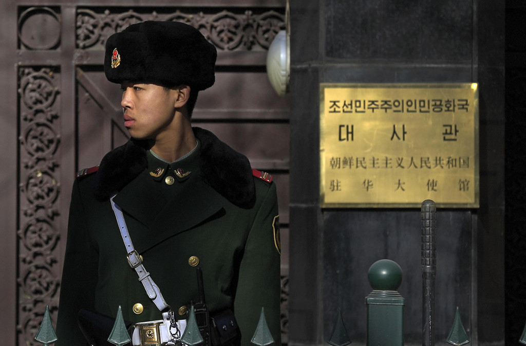 A Chinese paramilitary policeman stands guard outside the North Korean Embassy in Beijing, Wednesday. Relations between the two nations have cooled notably since Kim Jong Un's ascension to power in 2011, and the reclusive leader has yet to pay a visit to his most important sponsor and ally. The Associated Press