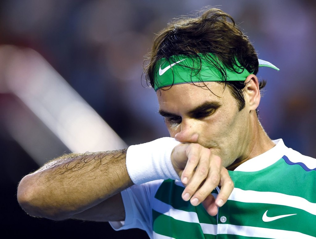 Roger Federer wipes the sweat from his face during his semifinal match against Novak Djokovic at the Australian Open tennis championships in Melbourne, Australia, Thursday. The Associated Press