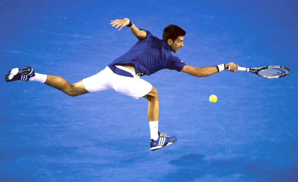 Novak Djokovic lunges to  return a volley during his semifinal match with Roger Federer at the Australian Open tennis championships in Melbourne, Australia, Thursday. The Associated Press