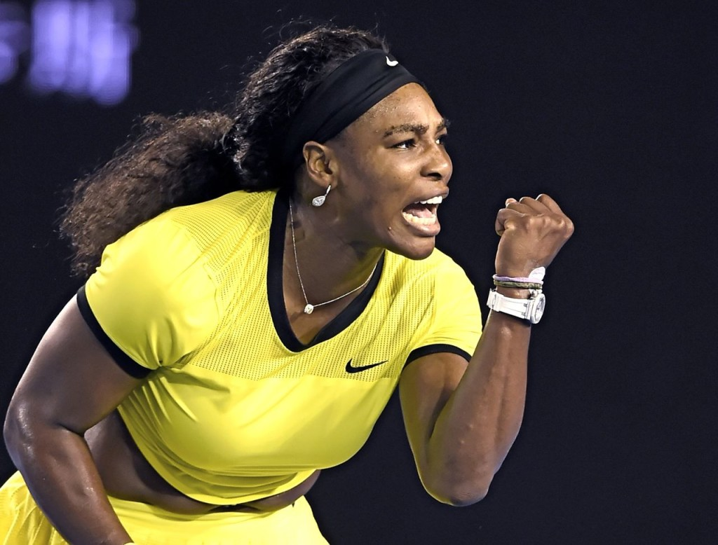 Serena Williams reacts after winning a point against Agnieszka Radwanska during their semifinal match at the Australian Open tennis championships in Melbourne. The Associated Press