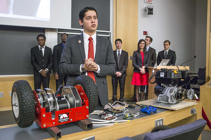 Harvard College junior Cesar Maeda explains a robotic snow blower to a group of university officials. Eighteen juniors representing several engineering disciplines spent the fall semester inventing devices to deal with snow and ice. The inventions grew out of last winter's record snowfall, which stretched campus maintenance department workers to their limit and forced a campus shutdown for the first time since the Blizzard of '78.