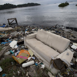 In 2013, a discarded sofa littered the shore of Guanabara Bay in Rio de Janeiro, Brazil. About 1,600 athletes will compete in Rio during the 2016 Summer Olympics. Experts say athletes will be competing in the viral equivalent of raw sewage with exposure to dangerous health risks almost certain.