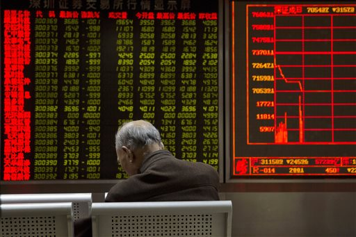 A display board at a brokerage in Beijing shows the plunge in the Shanghai Composite Index Thursday. Chinese stocks nosedived Thursday, triggering the second daylong trading halt of the week and sending other Asian markets sharply lower as investor jitters rippled across the region. The Associated Press