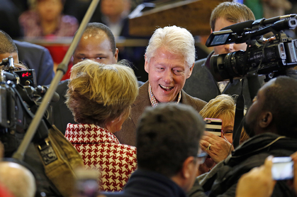 Former President Bill Clinton greets voters during a campaign stop for his wife, Democratic presidential candidate Hillary Clinton, Monday in Nashua, N.H. The Associated Press