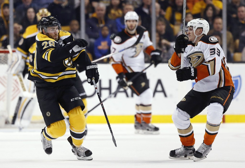 Boston's Landon Ferraro and Anaheim's Jakob Silfverberg battle for the puck during the Ducks' 6-2 win Tuesday night in Boston.