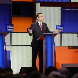 Republican presidential candidate Sen. Ted Cruz, R-Texas, center, answers a question as retired neurosurgeon Ben Carson, left, and Sen. Marco Rubio, R-Fla., right, listen during a Republican presidential primary debate, Thursday, Jan. 28, 2016, in Des Moines, Iowa. (AP Photo/Charlie Neibergall)