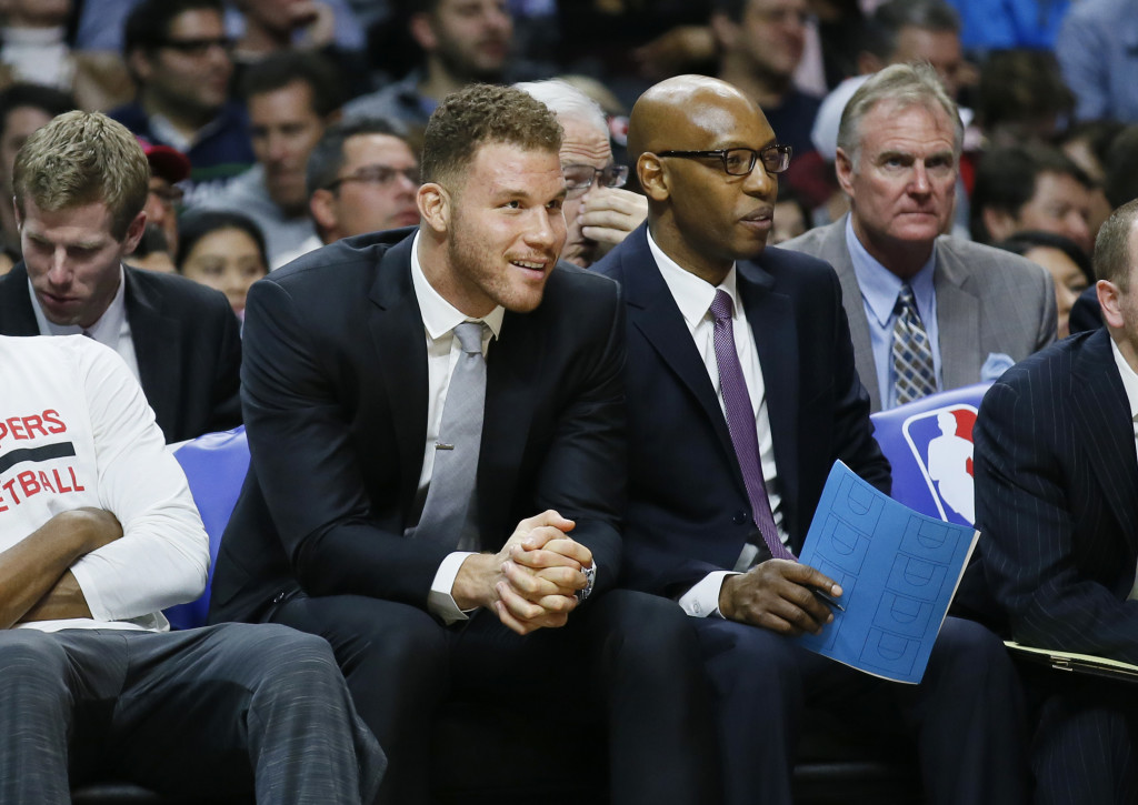 The Clippers' Blake Griffin, left, will miss 4 to 6 weeks with a broken hand after punching a member of his team's staff.