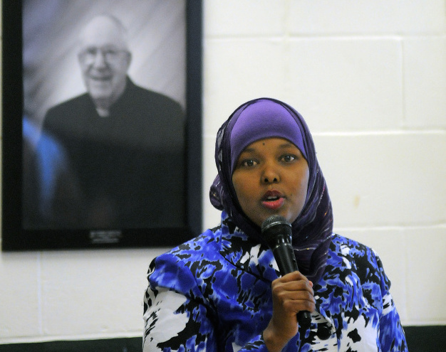 Fahmo Ahmed of Lewiston describes her migration to Maine from her native Somalia during a Martin Luther King Day forum at St. Francis Xavier Roman Catholic Church in Winthrop on Monday.