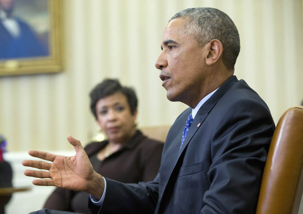 Attorney General Loretta Lynch listens as President Obama speaks in the Oval Office on Monday in a meeting with law enforcement officials to discuss executive actions the president can take to curb gun violence. The Associated Press