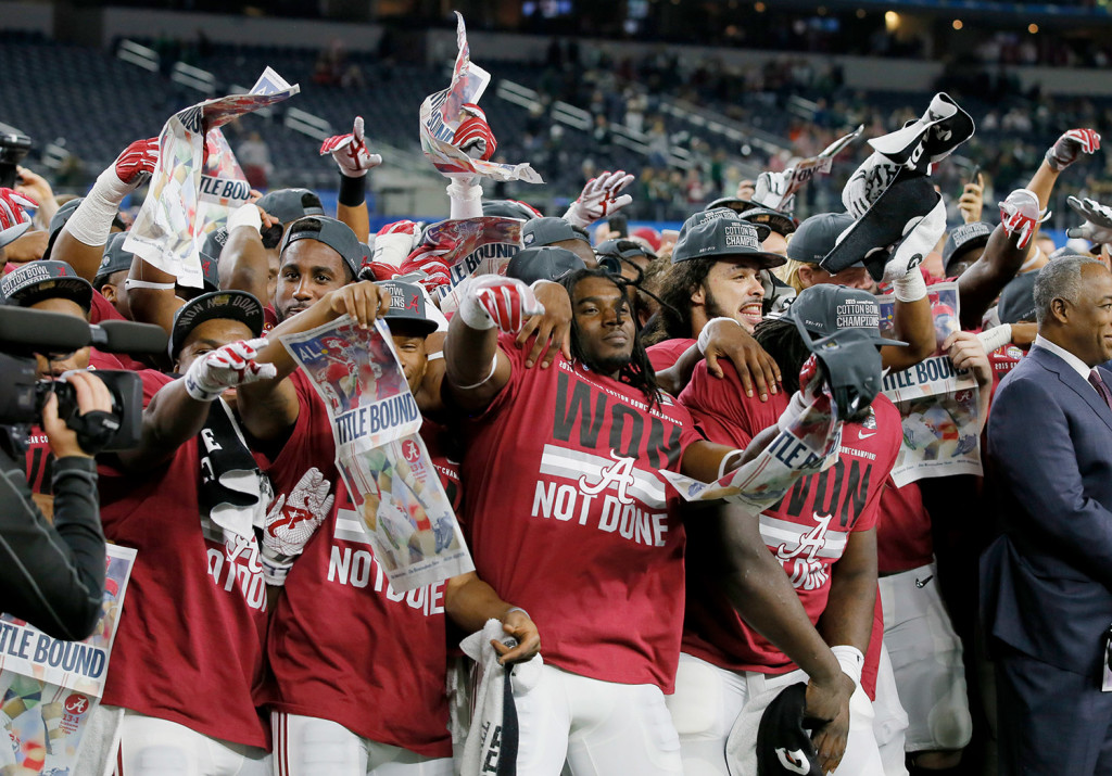 Alabama celebrates its Cotton Bowl win against Michigan State and its berth in the national championship game. The Associated Press