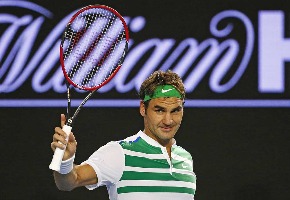 Switzerland's Roger Federer acknowledges cheers from the crowd after winning his third round match against Bulgaria's Grigor Dimitrov at the Australian Open tennis tournament at Melbourne Park, Australia, Friday. Reuters