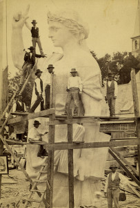Hallowell sculptors working on statue, 1877: Statuary cutter Joseph Archie stood on a 36-foot sculpture, part of a project commissioned by the National Monument to the Forefathers in Plymouth, Massachusetts. Italian immigrant Protasio Neri supervised the carving of the project's base statues.