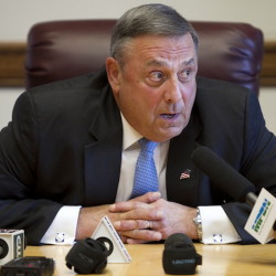 Gov. Paul LePage speaks to reporters shortly after the Maine House and Senate both voted to override his veto of the state budget, Wednesday, June 26, 2013, at the State House in Augusta, Maine.  (AP Photo/Robert F. Bukaty)