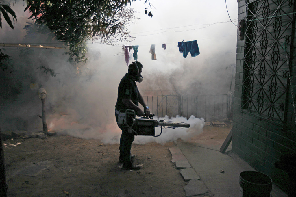 A health worker fumigates the Altos del Cerro neighborhood as part of preventive measures against the Zika virus and other mosquito-borne diseases in Soyapango, El Salvador, on Thursday. Reuters