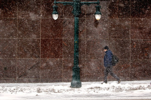 A man makes his way down Congress Street through wind-blown snow on Monday. Gregory Rec/Staff Photographer