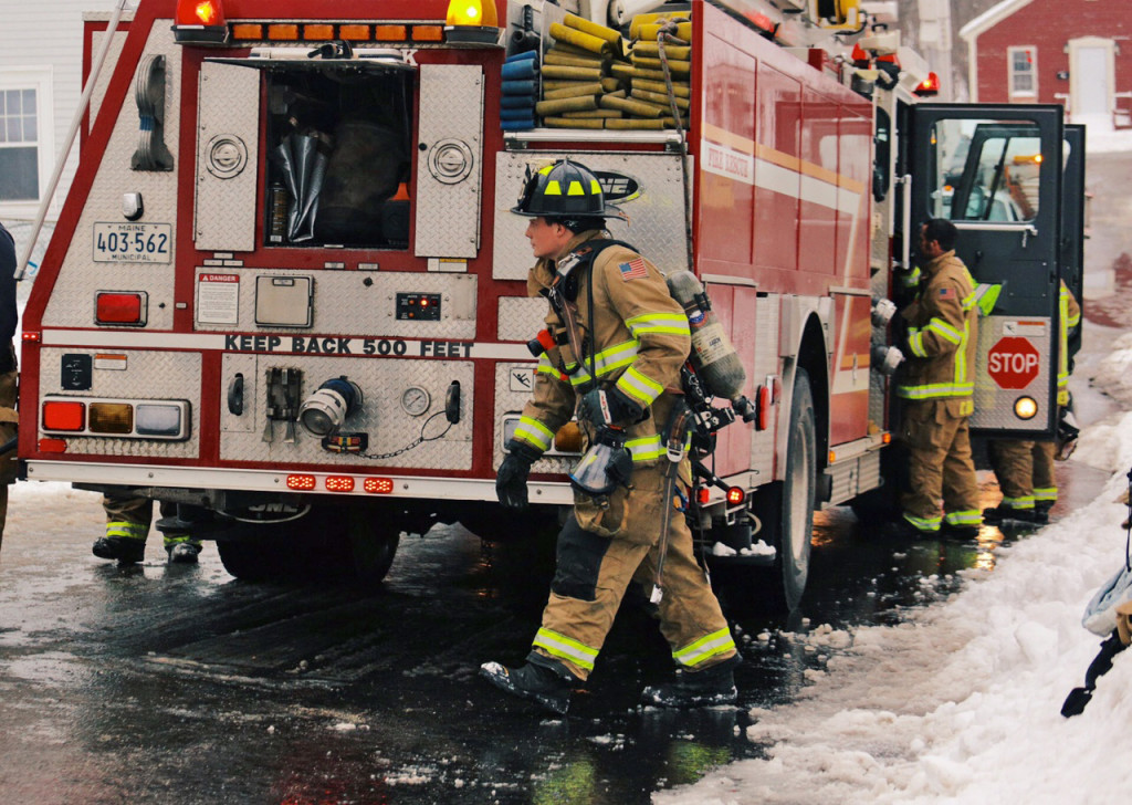 Firefighters at the scene of a fire at 14 River St. in Westbrook. Whitney Hayward/Staff Photographer