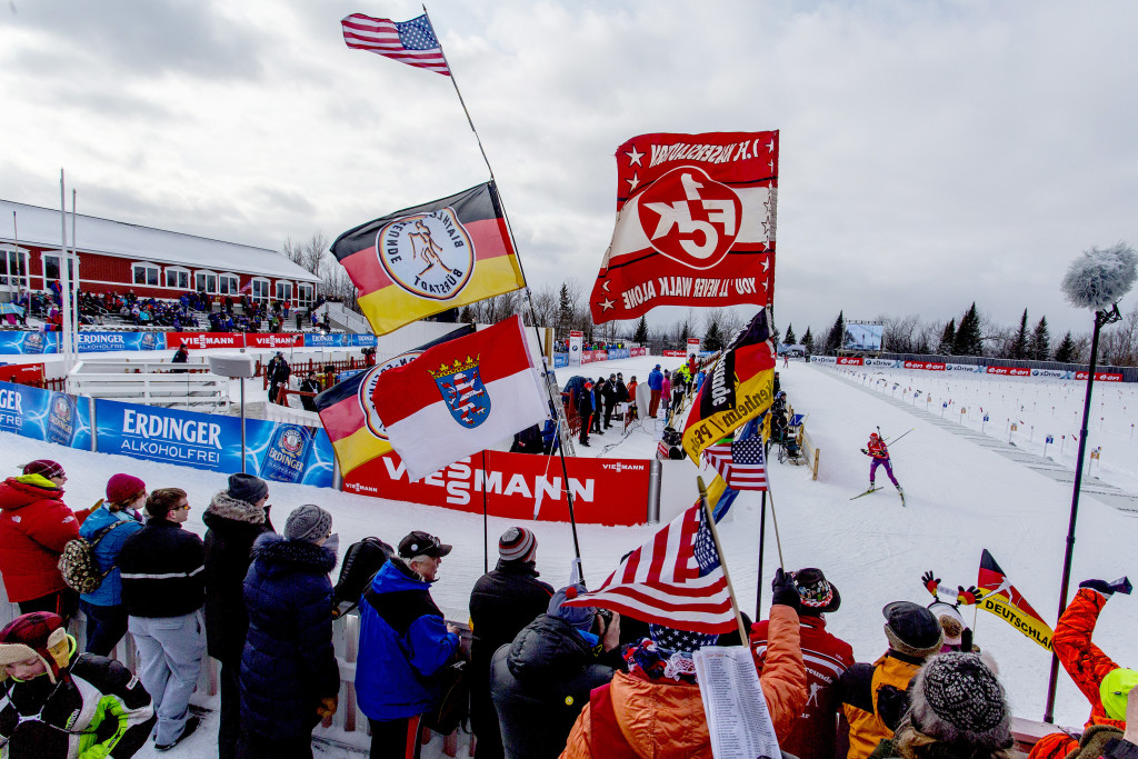 Fans cheer as Susan Dunklee of Barton, Vermont, skis past the grandstand after shooting from the prone position on the first lap of the women's 7.5-kilometer sprint at the BMW IBU World Cup Biathlon in Presque Isle. Dunklee went on for a second-place finish, the best ever by an American woman.