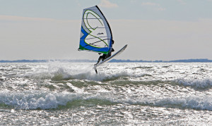 Scott Furr tackles wind and waves on a mild first day of February at Pine Point Beach in Scarborough.