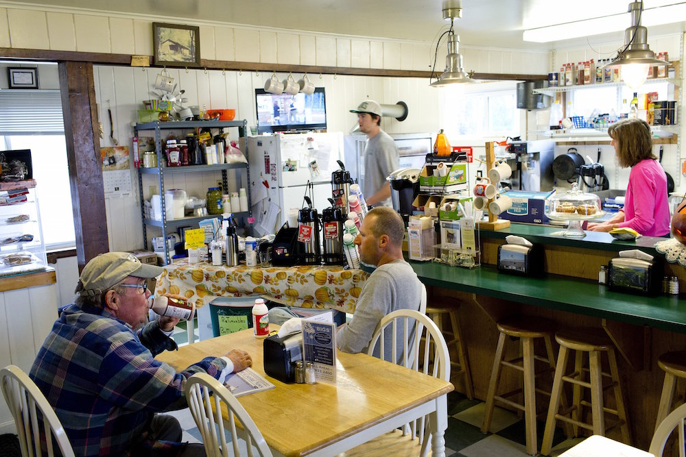 BAILEY ISLAND, ME - NOVEMBER 6: Teri Pontbriand, owner of Bailey Island General Store, at right, makes a reuben sandwich for the Eat & Run feature, Friday, November 6, 2015, as regular patrons enjoy a glass of milk in the restaurant area of the store.