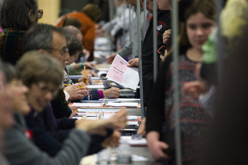 Voters collect their ballots at a polling place inside Bedford High School, Tuesday in Bedford, N.H. The Associated Press