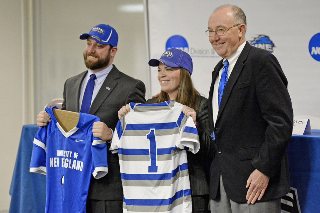 UNE Athletic Director Jack McDonald, right, introduces then-new football coach Mike Lichten and new women's rugby coach Ashley Potvin at the University of New England on Feb. 4, 2016.