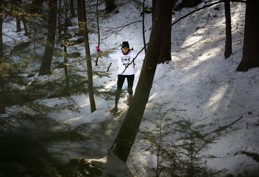Baxter Outdoors hosts a snowshoe race at Lost Valley Ski Area on Jan. 30. Linda Davis traverses trail in the woods while competing in the 5k race. Derek Davis/Staff Photographer