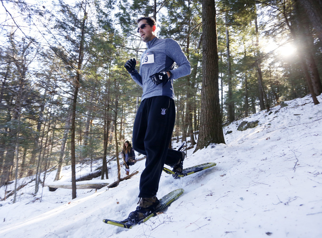 Shawn Walker traverses a trail in the woods during the 5k race. Derek Davis/Staff Photographer
