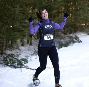 Baxter Outdoors host a snowshoe race at Lost Valley Ski Area on Jan. 30. Mary Costigan celebrates after making it out of the trees and nearing the finish of the 5k race Derek Davis/Staff Photographer