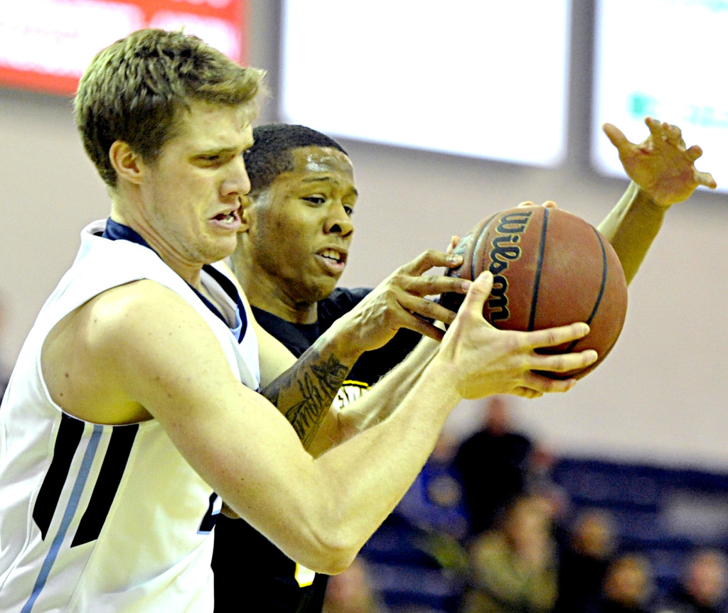 UMaine's Till Gloger fights for control of a rebound with UMBC's Jairus Lyles. Gabe Souza/Staff Photographer