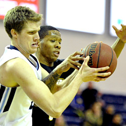 UMaine's Shaun Lawton  fights for control of a rebound with UMBC's Jairus Lyles. Gabe Souza/Staff Photographer