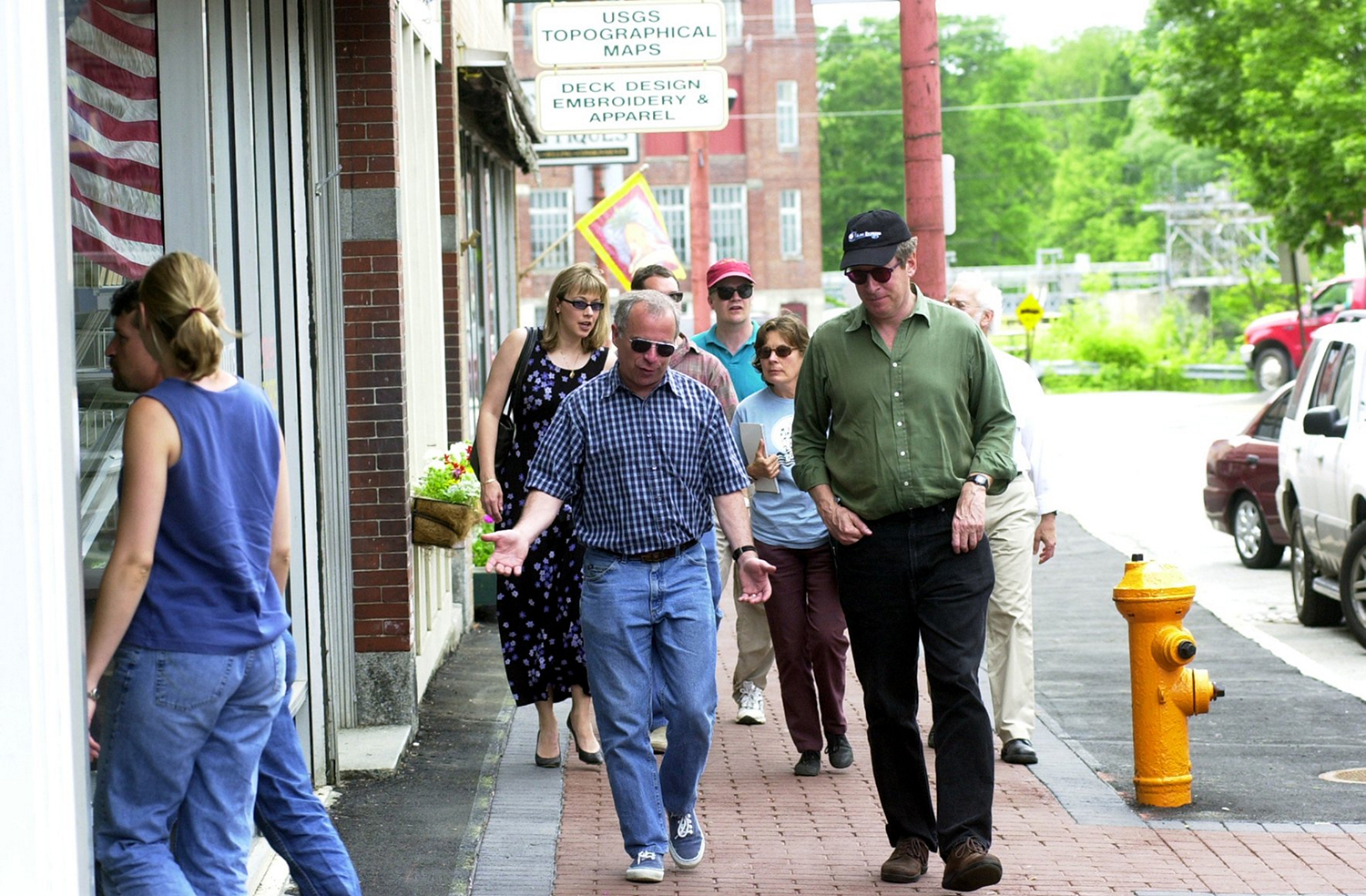 Pulitzer prize winning writer Richard Russo, center, author of Empire Falls, speaks with independent producer Bill Teitler while touring Water Street in Skow. Wed. Both independent and HBO producers and production designers, Lea Girardin, director of the Maine Film Office and Kim Lindl of of the Mid-Maine Chamber of Commerce looked at Waterville and Skowhegan as possible sites for the movie.