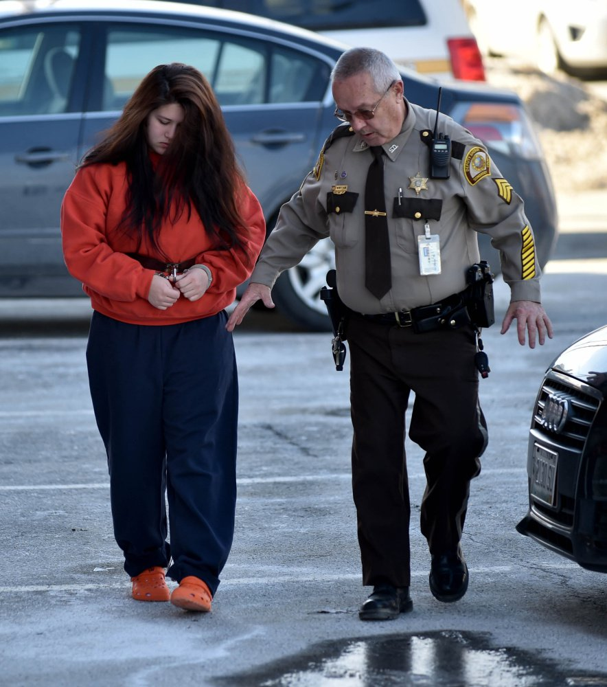 Kayla Stewart is escorted into Somerset County Superior Court in Skowhegan on Friday.