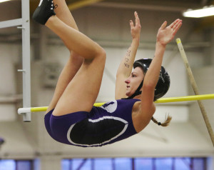 Waterville senior Alison Linscott clears the bar during the pole vault event of the Class B State track championship.