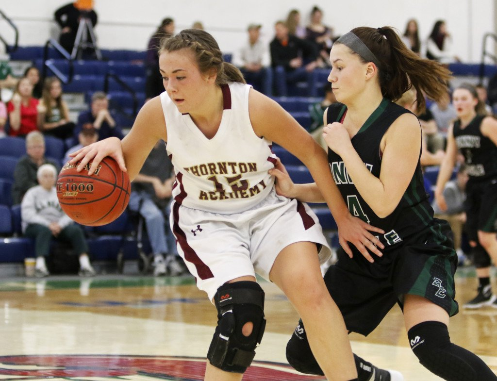 Thornton Academy's Barrett Campbell moves the ball with pressure from Bonny Eagle's Cassidy Emery during the first half of Wednesday's quarterfinal. (Jill Brady/Staff Photographer)
