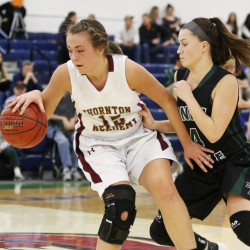 Thornton Academy's Barrett Campbell moves the ball with pressure from Bonny Eagle's Cassidy Emery during the first half of Wednesday's quarterfinal. Jill Brady/Staff Photographer