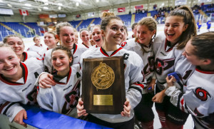 Scarborough captain Madison O'Reily, a senior, holds the winner's plaque Wednesday after Scarborough beat Falmouth 5-2 at the South regional final at Androscoggin Bank Colisée. Ben McCanna/Staff Photographer