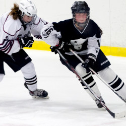 Greely senior Maura Verrill tries to stop St. Dominic freshman Isabelle Frenette.
